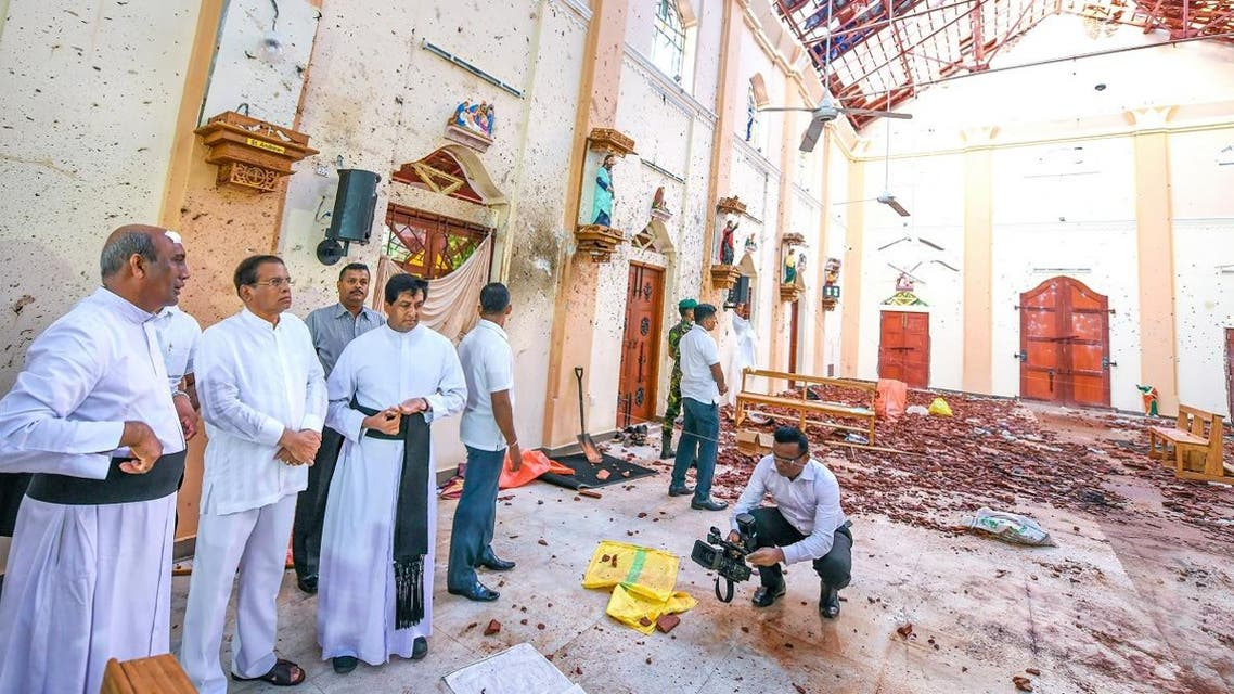 This handout photo taken and released by the Sri Lankan President's Office on April 23, 2019 shows President Maithripala Sirisena (3rd L) visiting St. Sebastian's church in Negombo, two days after the bombings. (AFP)