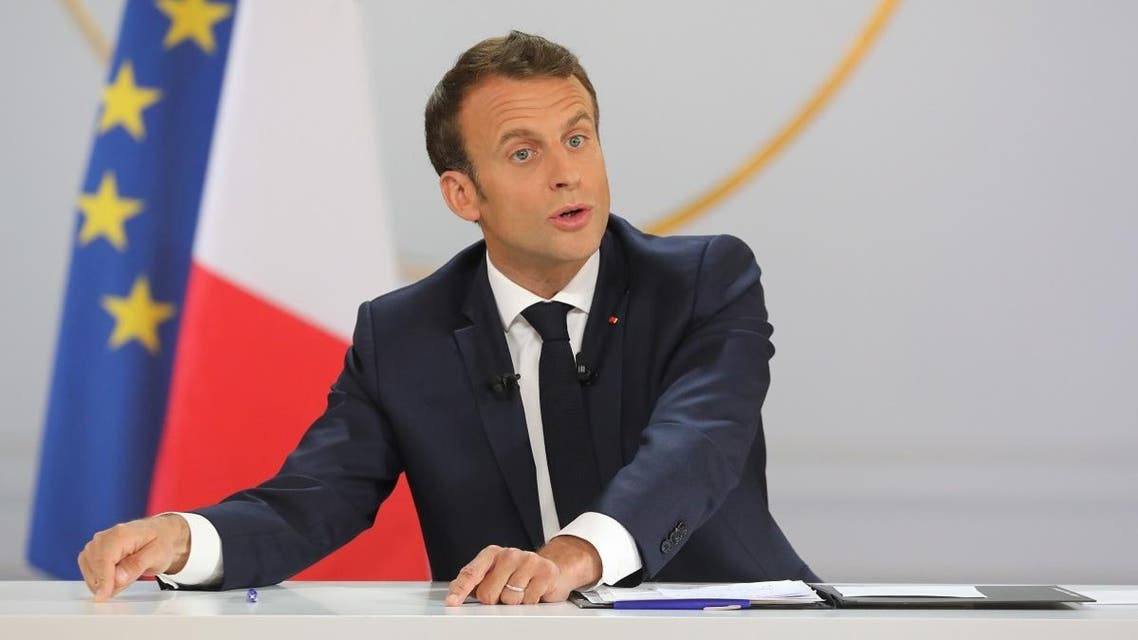 """French President Emmanuel Macron gestures during his live address following the """"Great National Debate"""", at the Elysee Palace in Paris on April 25, 2019. (AFP)"""