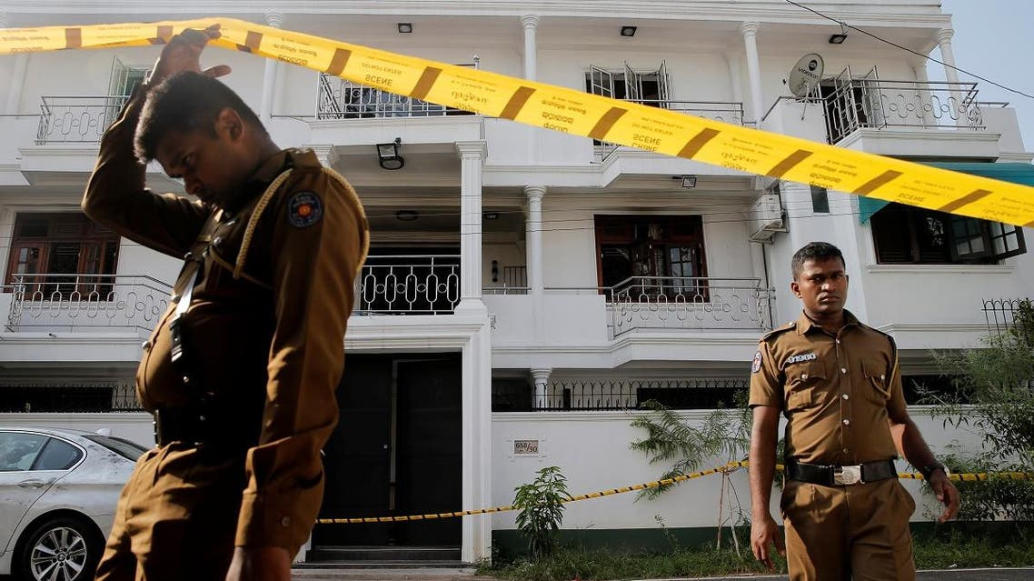Police keep watch outside the family home of a bomber suspect where an explosion occurred during a Special Task Force raid, following a string of suicide attacks on churches and luxury hotels, in Colombo, Sri Lanka, on April 25, 2019. (Reuters)