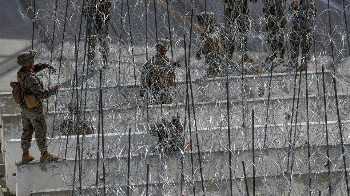 U.S. Marines help to build a concertina wire barricade at the U.S. Mexico border in preparation for the arrival of a caravan of migrants at the San Ysidro border crossing in San Diego. (Reuters)