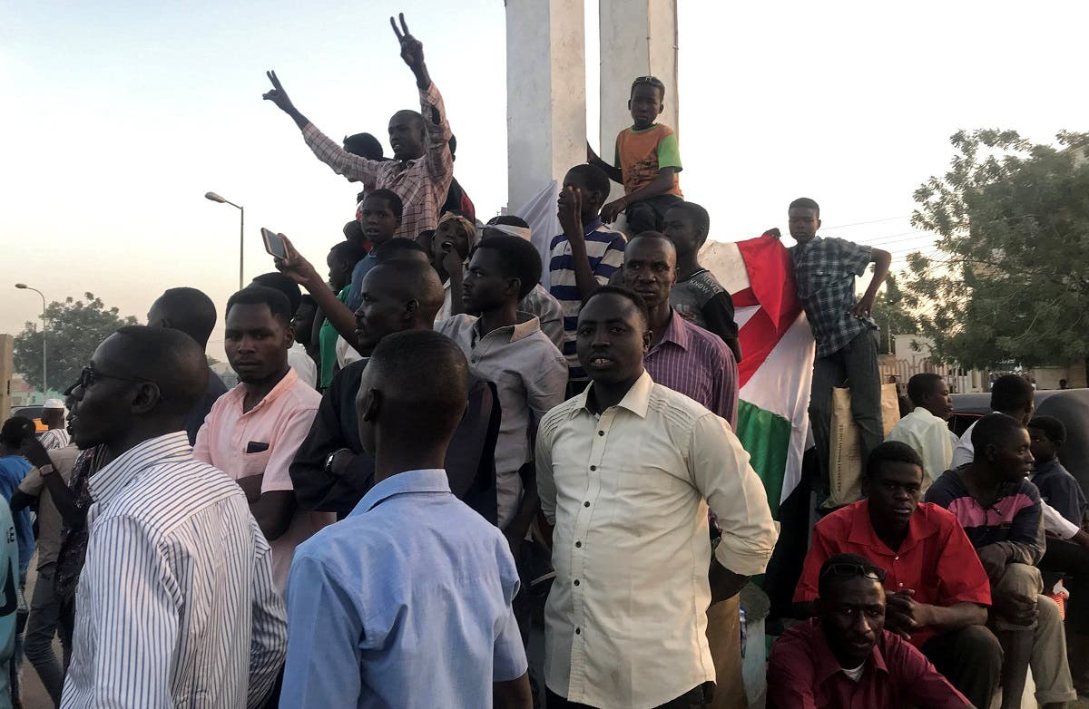 Sudanese demonstrators chant slogans as they attend a mass anti-government protest at the Nyala market in South Darfur, Sudan, on April 24, 2019. (Reuters)