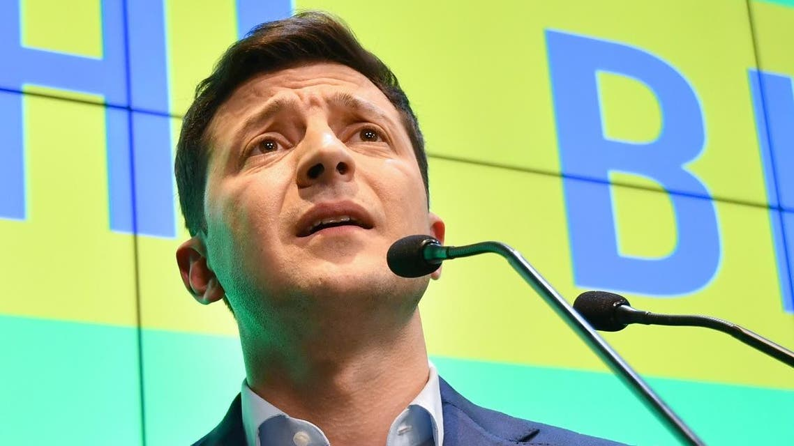 Ukrainian comedian and presidential candidate Volodymyr Zelensky listens to journalists during press conference at his campaign headquarters in Kiev. (AFP)