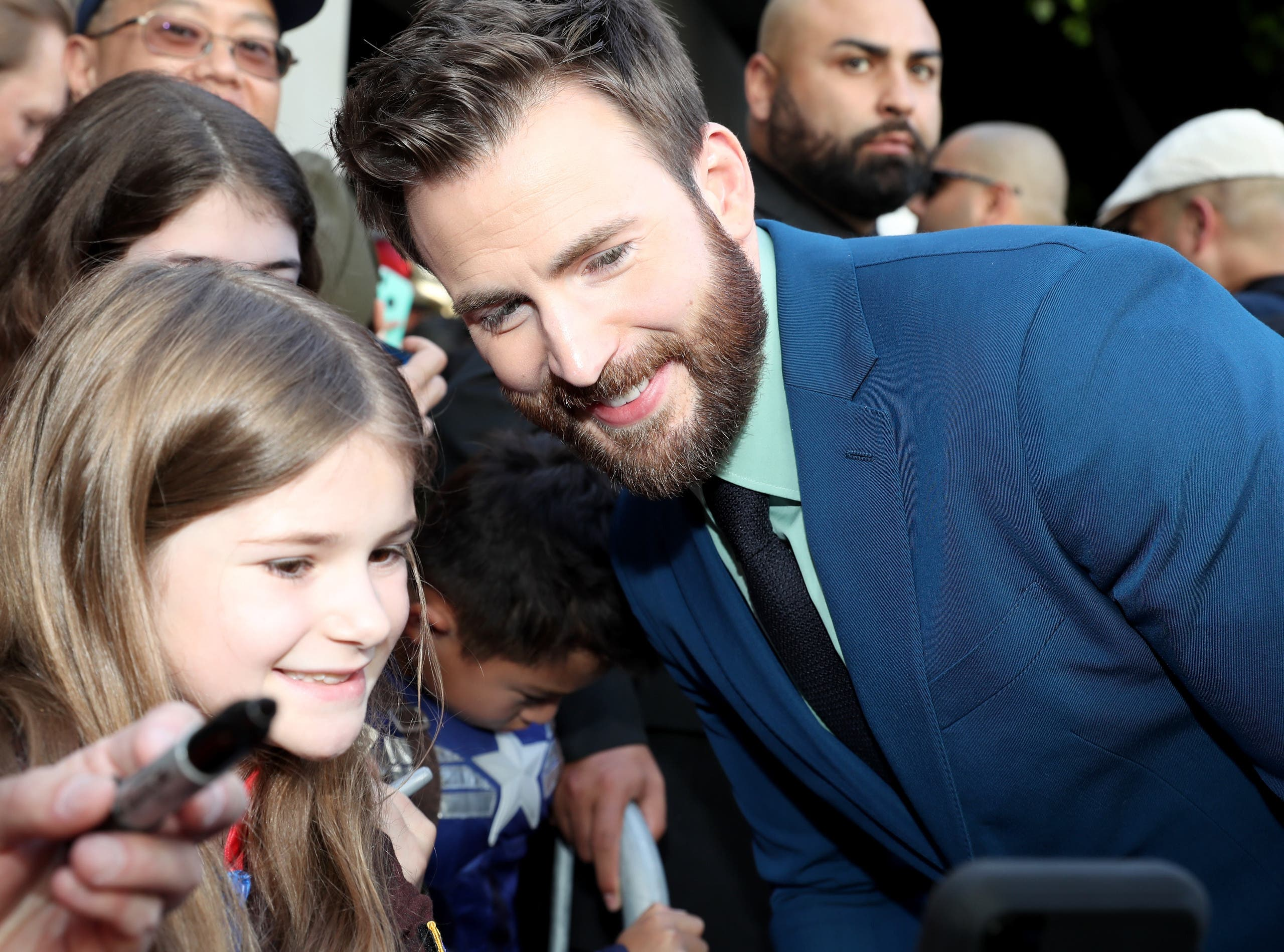Chris Evans poses for a photo with a fan at the Avengers: Endgame premiere. (AFP)