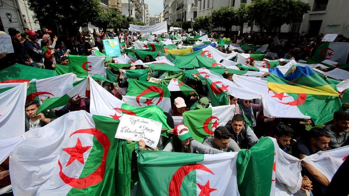 Demonstrators hold flags and banners during anti government protests in Algiers, Algeria April 23, 2019. (Reuters)