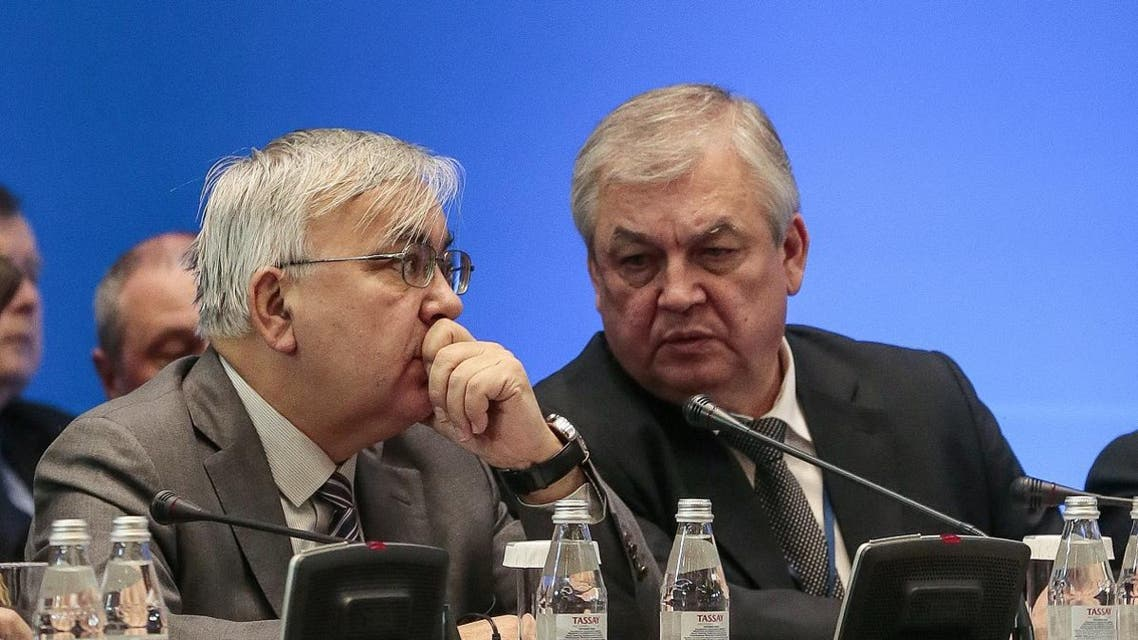 Aleksandr Lavrentyev (R), Russia's chief negotiator for Syria, attends the session of Syria peace talks in Astana on December 22, 2017. (AFP)