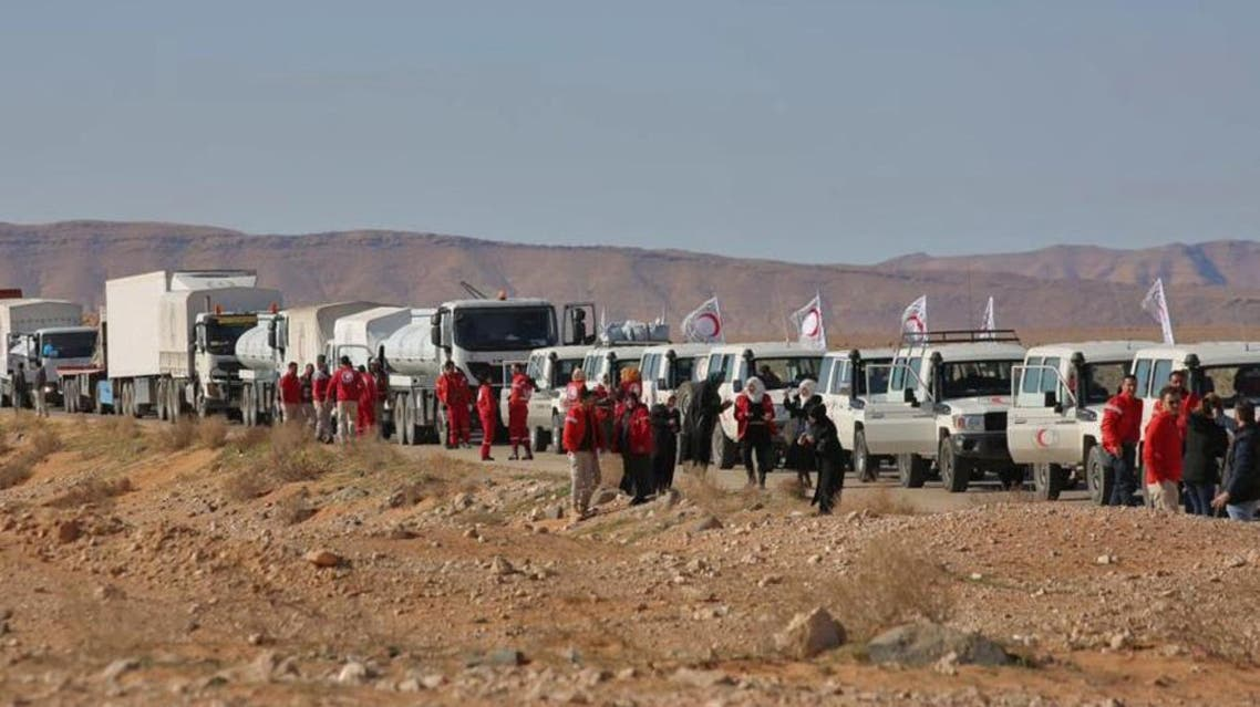 This picture shows an aid convoy of the Red Crescent arriving at the Rukban desert camp for displaced Syrians along Syria's border with Jordan on February 06, 2019. (AFP)