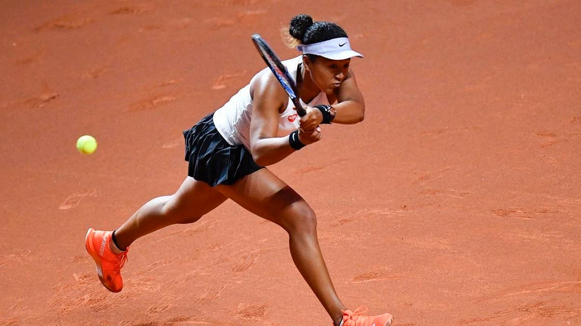 Japan's Naomi Osaka returns the ball to Taiwan's Su-Wei Hsieh during their round-of-16 match at the WTA Tennis Grand Prix in Stuttgart. (Reuters)