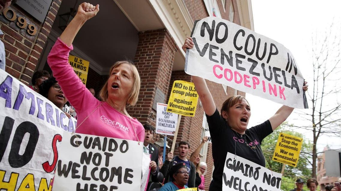 Medea Benjamin (L) and Ariel Gold (R) of CodePink shout slogans during a news conference outside the Embassy of Venezuela April 25, 2019 in Washington, DC. (AFP)