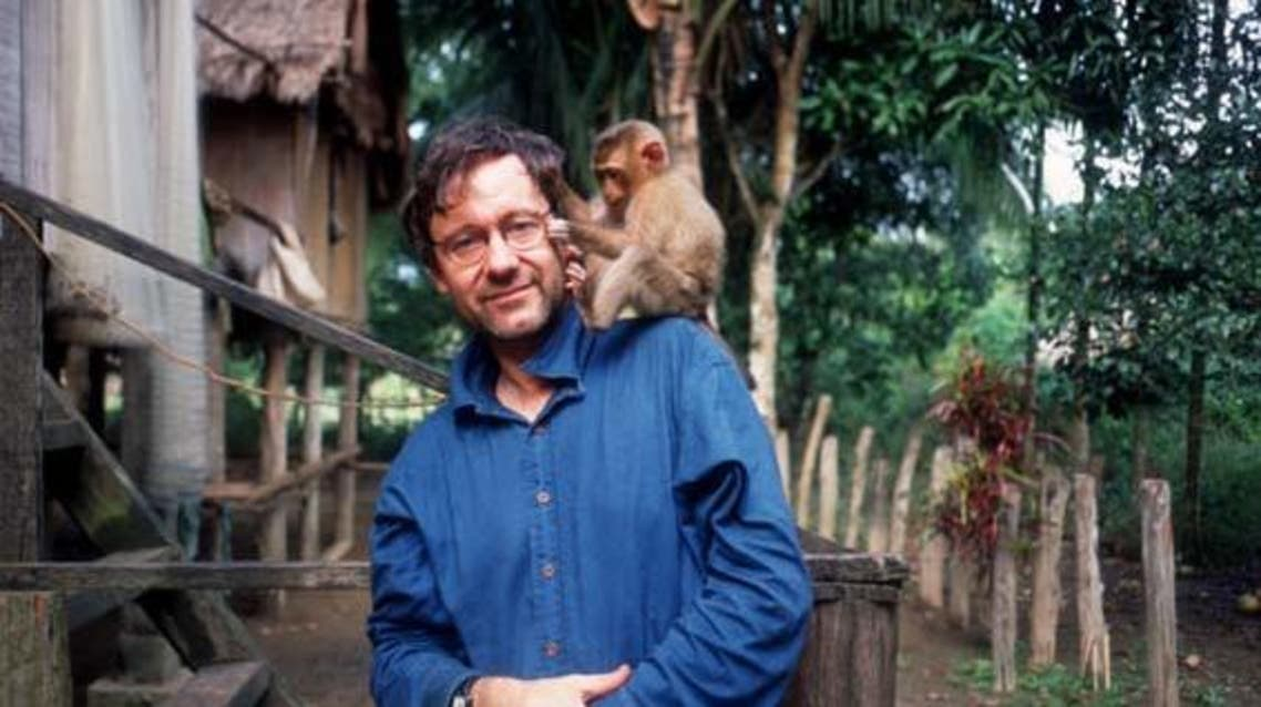 photographer michael wolf with a monkey (The Michael Wolf Website)