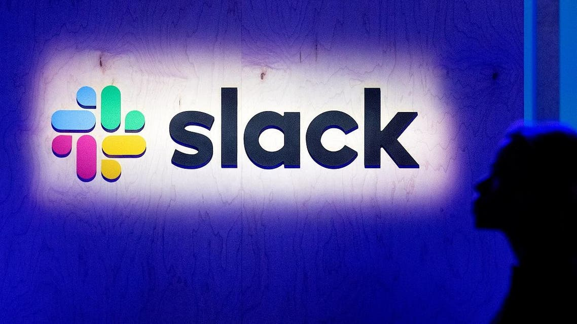 An attendee walks by the company's logo during Slack's Frontiers conference at Pier 27 & 29 in San Francisco. (File photo: AFP)