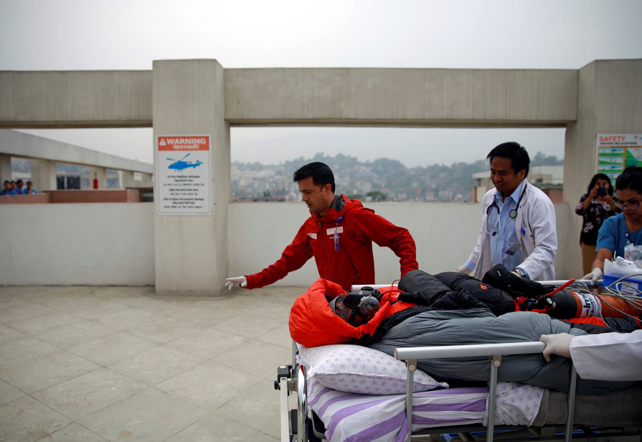Malaysian climber Wui Kin Chin is being transferred from a helicopter to the hospital for treatment after being rescued from Mount Annapurna in Kathmandu (AP)