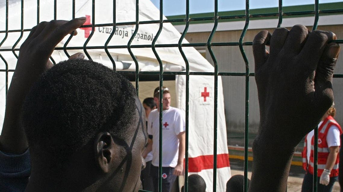 An immigrant looks at a Spanish Red Cross tent at a temporary shelter in the Spanish enclave of Melilla. (AFP)
