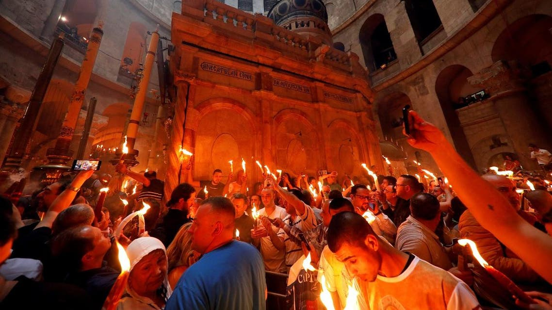 Worshippers take part in the Christian Orthodox Holy Fire ceremony at the Church of the Holy Sepulchre in Jerusalem's Old City. (Reuters)