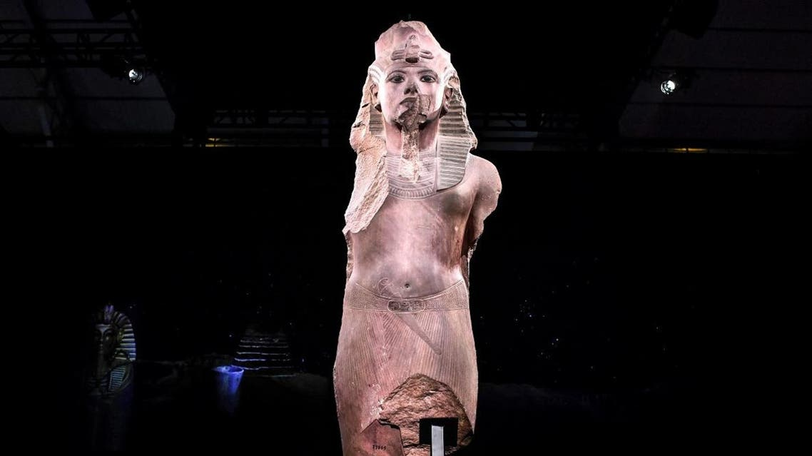 A sculpture of 'Tutankhamun usurped by Horemheb', is displayed during the exhibition 'Tutankhamun,Treasures of the Golden Pharaoh' on March 21, 2019 at La Villette in Paris. (AFP)