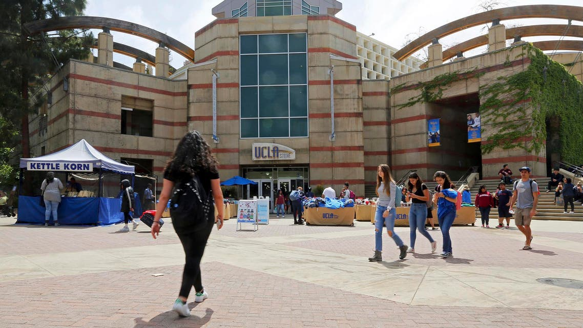 People pass Ackerman Student Union on the campus of the University of California, Los Angeles Friday, April 26, 2019.  (AP)
