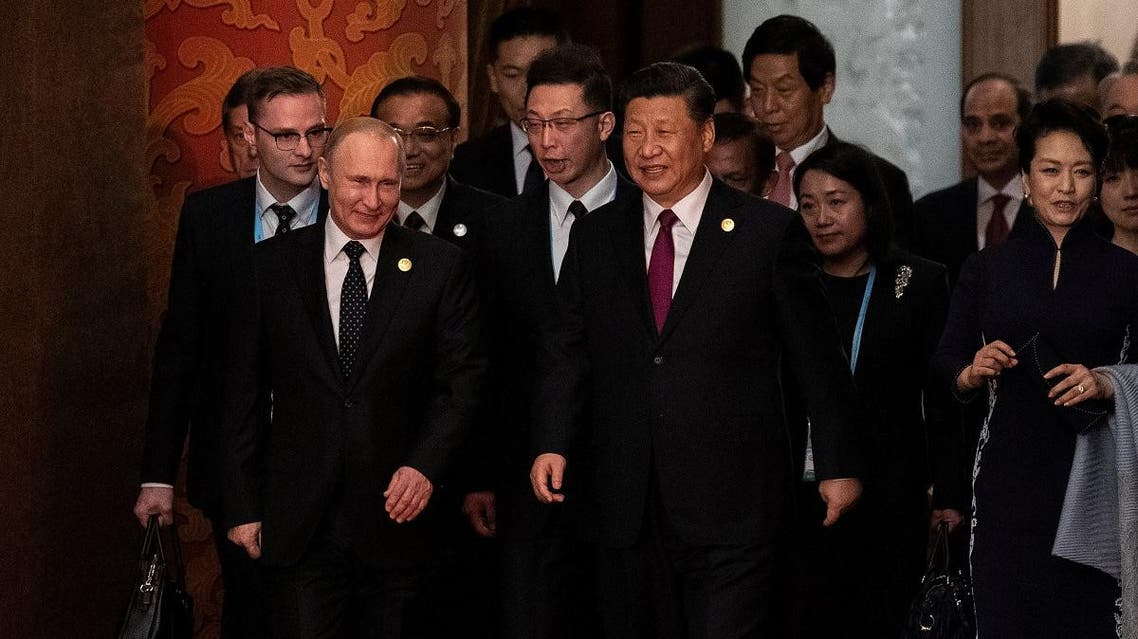 Russian President Vladimir Putin and Chinese President Xi Jinping arrive for a welcoming banquet at the Belt and Road Forum at the Great Hall of the People in Beijing, China, on April 26, 2019. (Reuters)