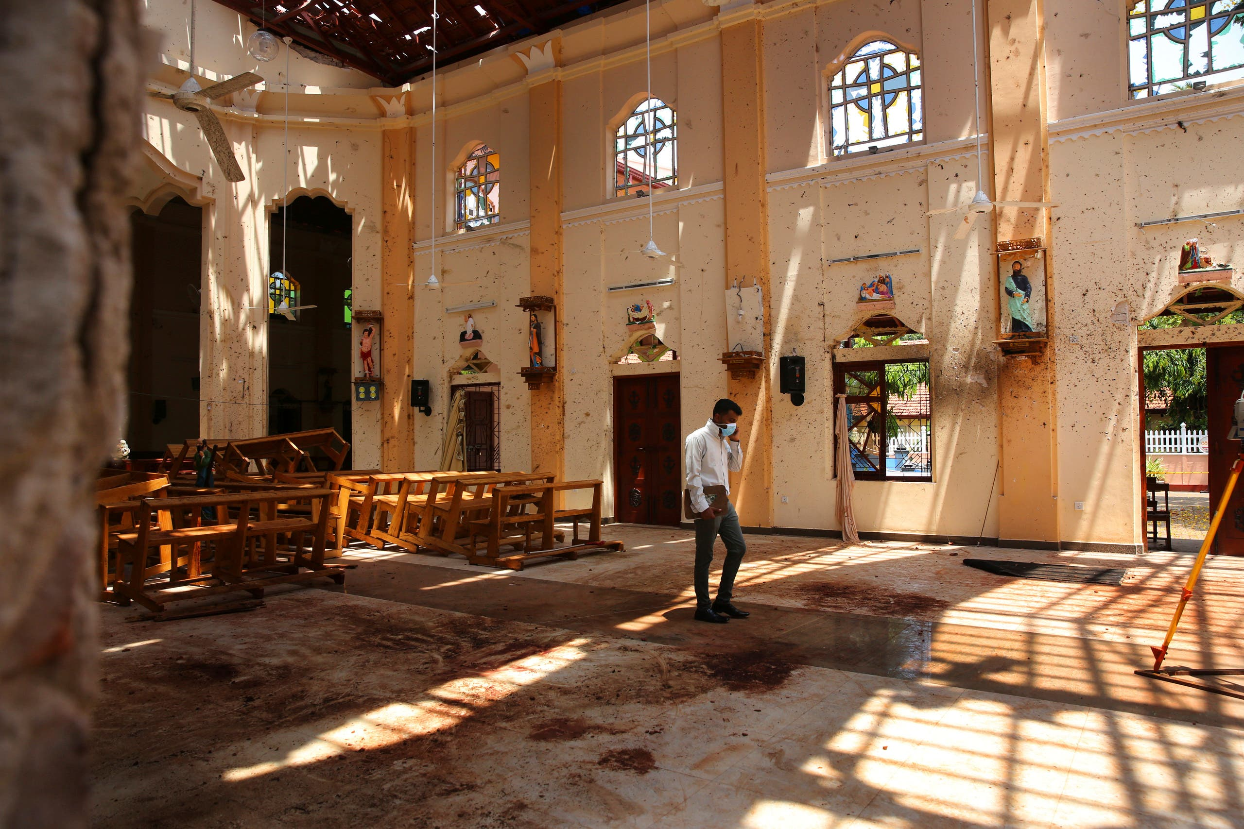n this Thursday, April 25, 2019 photo, a surveyor walks inside the damaged St. Sebastian's Church where a suicide bomber blew himself up on Sunday Easter in Negombo, north of Colombo, Sri Lanka. (AP)