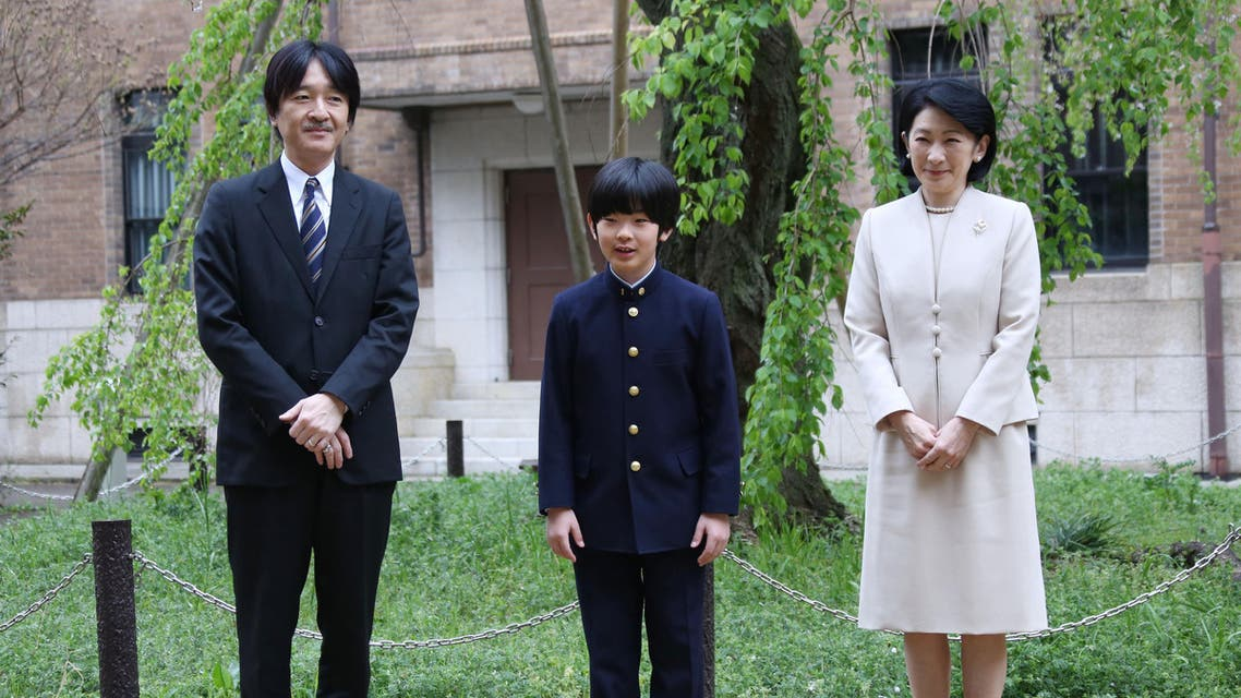 In this file photo taken on April 8, 2019 Japan's Prince Hisahito (C) and his parents Prince Akishino (L) and Princess Kiko (R) pose for photos at Ochanomizu University junior high school before attending the entrance ceremony in Tokyo. (AFP)