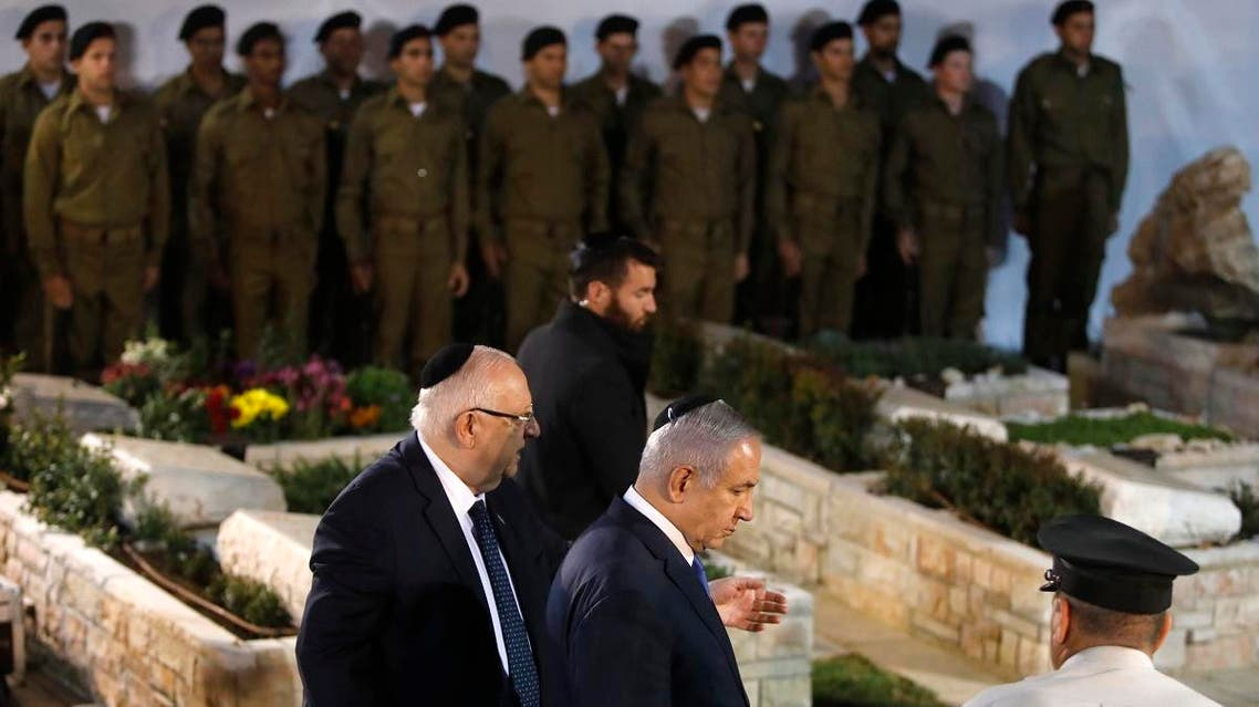PM Benjamin Netanyahu (2nd-R) during the burial procession of the remains of  Israeli soldier Zachary Baumel at the Mount Herzl military cemetery in Jerusalem on April 4 2019.  (Reuters)