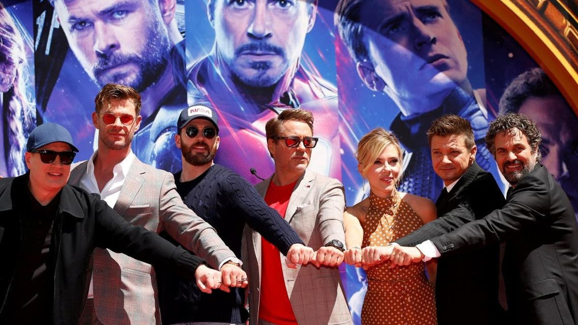The cast of the Avengers pose for a picture during a ceremony to place their handprints in cement. (Reuters)