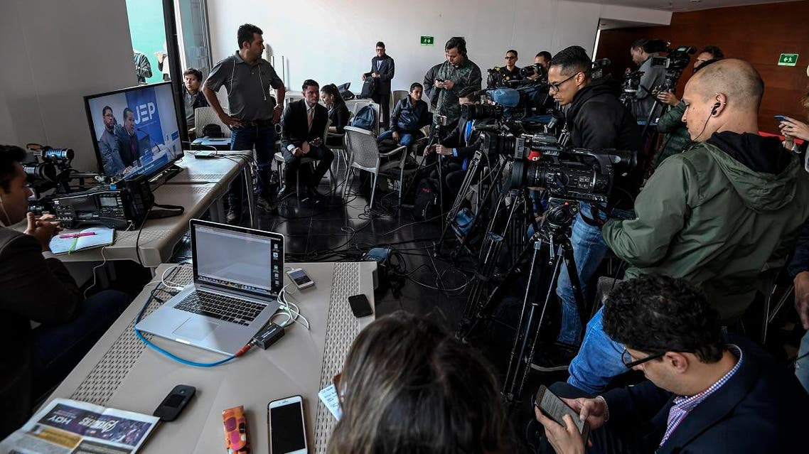 """Journalists cover the hearing of former Commander of the Colombian Revolutionary Armed Forces (FARC) Hernan Dario Velasquez Saldarriaga, aka """"El Paisa."""" (AFP)"""