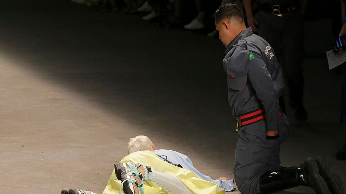 Model Tales Soares is taken from the catwalk by paramedics after he collapsed during Sao Paulo Fashion Week in Sao Paulo, Brazil, Saturday, April 27, 2019. (AP)