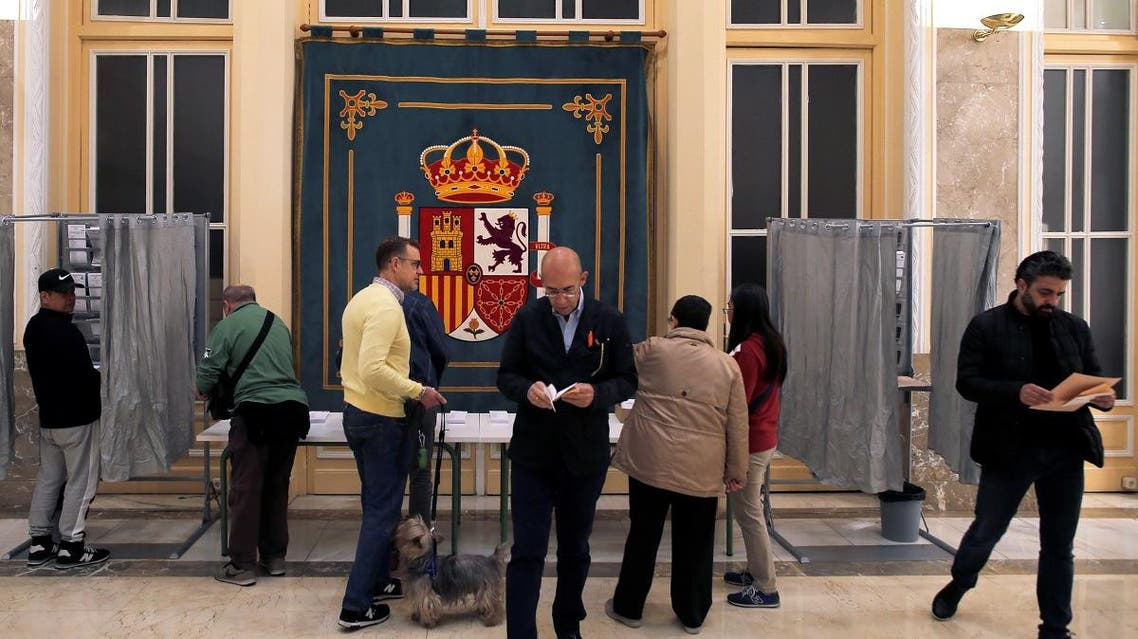 People prepare to cast their votes during Spain's general election in Madrid, Spain. (Reuters)