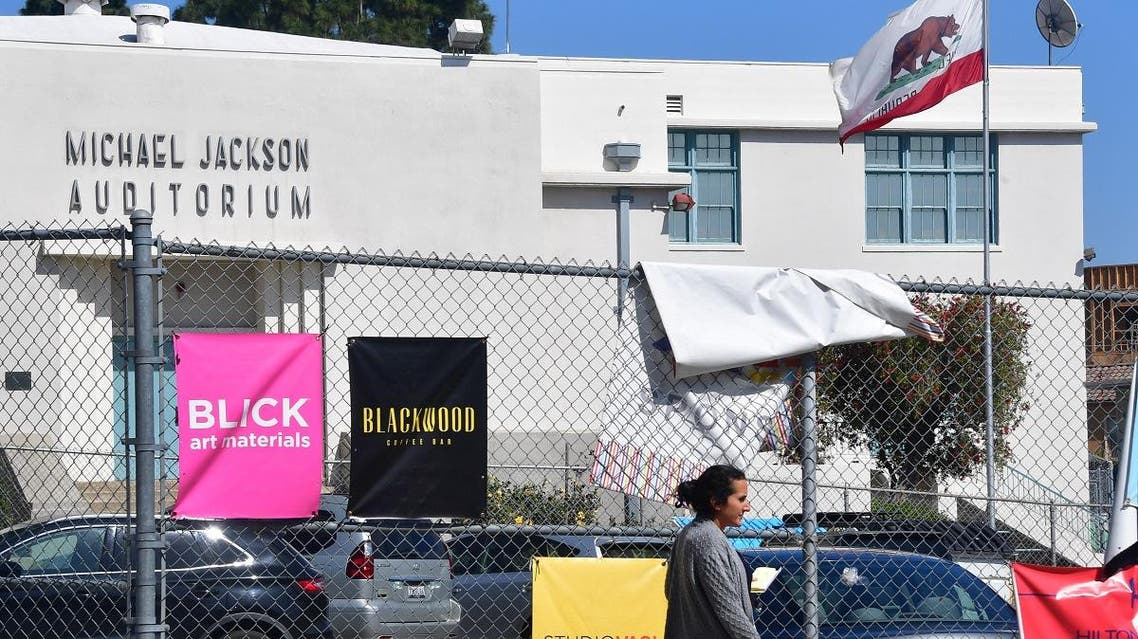 A woman walks past the Michael Jackson Auditorium at the Gardner Street Elementary school in Hollywood, California. (AFP)