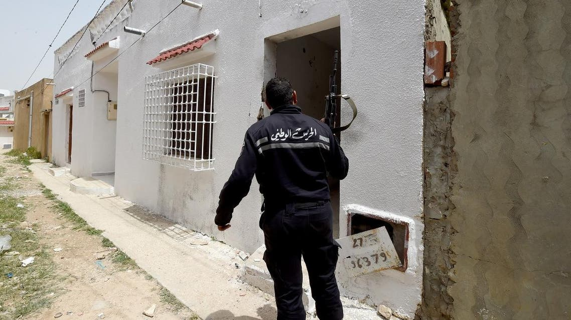 File photo of a Tunisian security officer outside a house where two suspected extremists were killed during a security operation in the country. (AFP)