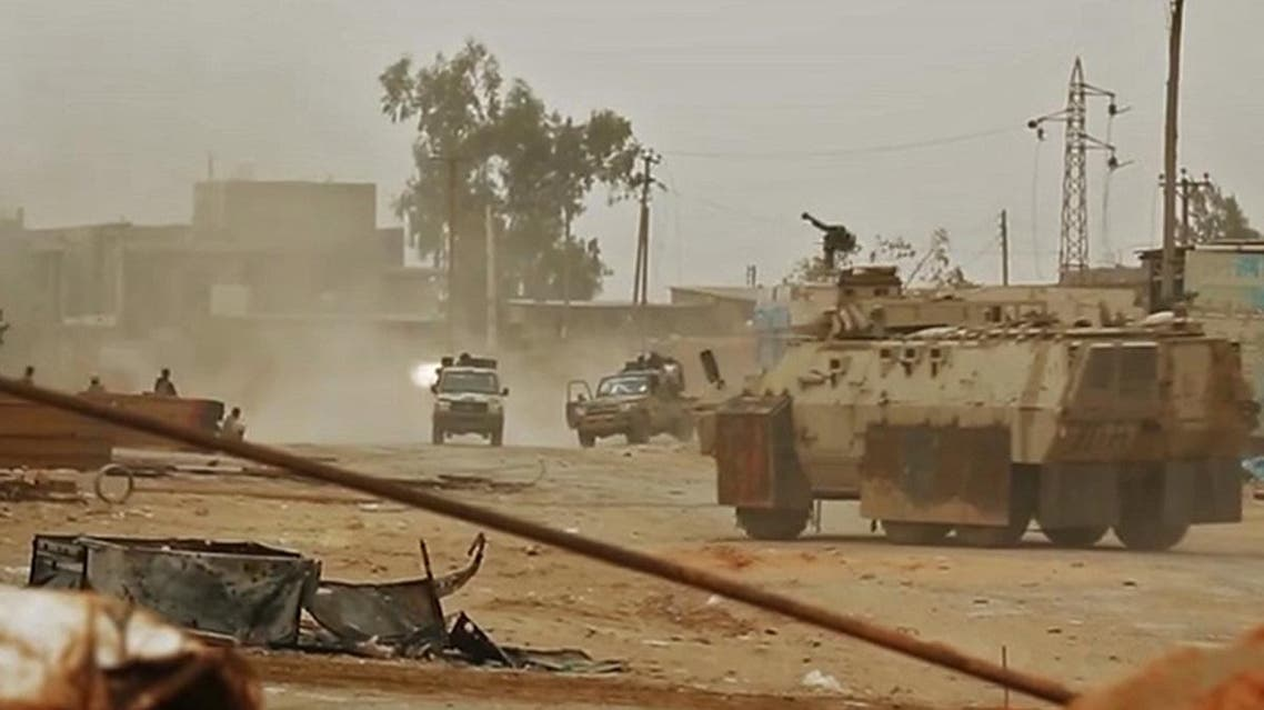 This video grab - showing armed vehicles firing reportedly during clashes with forces loyal to Libya's UN-recognized Government on the outskirts of the capital Tripoli - was published on Haftar's Libyan National Army (LNA) War Information Division's Facebook page on April 24, 2019. (AFP)
