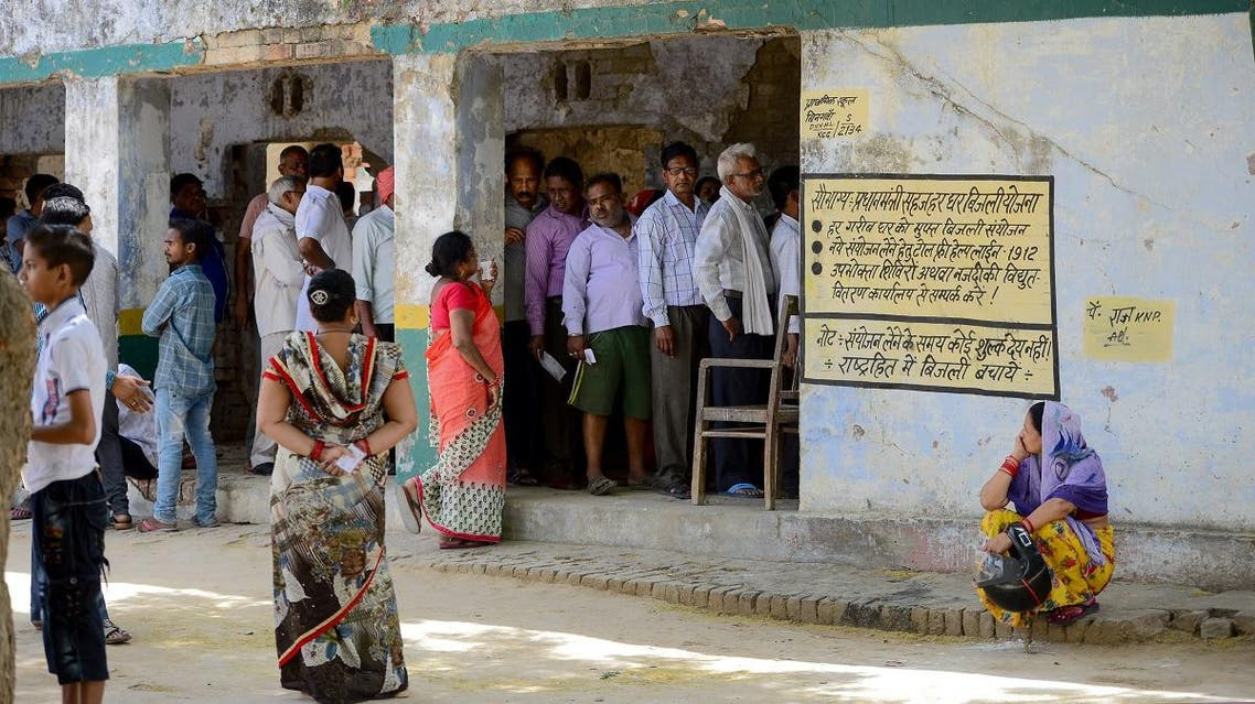 Indian voters stand in a queue to cast their vote at a polling station, in Kanpur. (AFP)