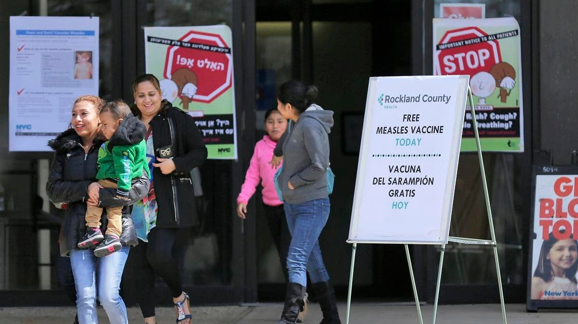 In this March 27, 2019 file photo, signs advertising free measles vaccines and information about measles are displayed at a Health center in NY. (AP)