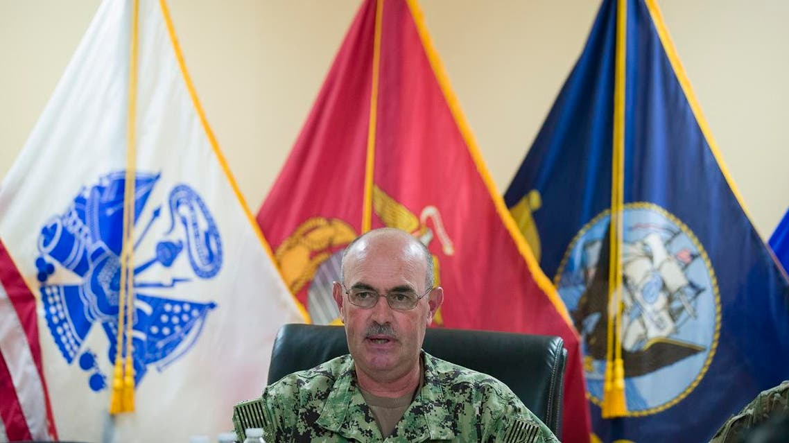 In this photo reviewed by U.S. military officials, U.S. Navy Rear Adm. John Ring, Joint Task Force Guantanamo Commander, speaks during a roundtable discussion with the media, Wednesday, June 17, 2019, in Guantanamo Bay Naval Base, Cuba. (AP Photo/Alex Brandon)