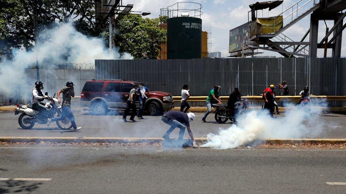 "Opposition demonstrators clash with security forces near the Generalisimo Francisco de Miranda Airbase ""La Carlota"" in Caracas, Venezuela. (Reuters)"
