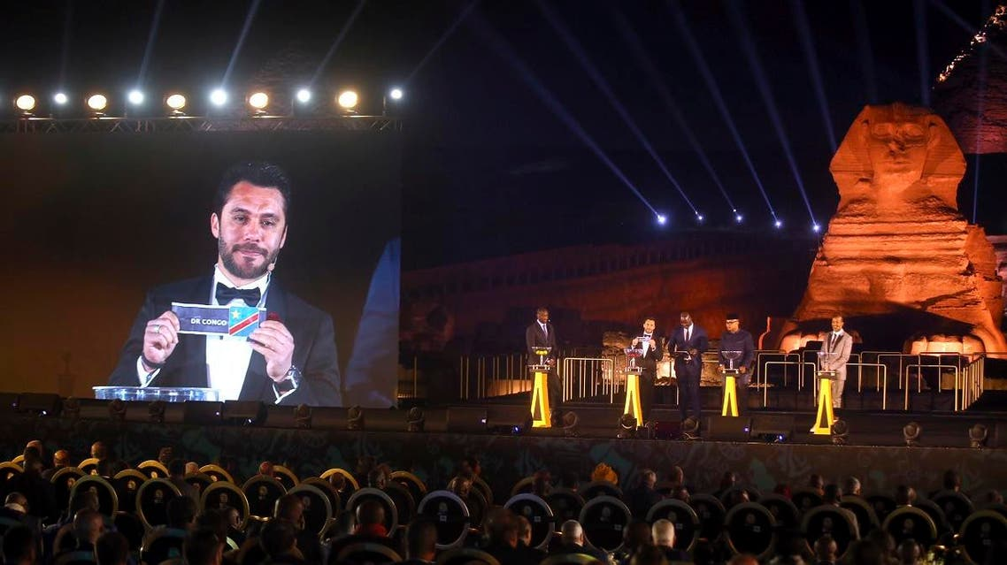 Former Egyptian soccer player Ahmed Hassan is shown on the screen as he participates in the draw for the African Cup of Nations soccer tournament at the historical site of the Giza Pyramids and Sphinx in Cairo. (AP)