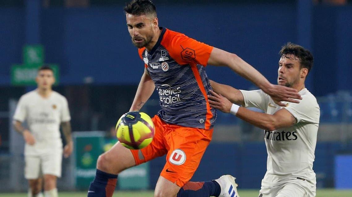Montpellier's Damien Le Tallec in action with Paris St Germain's Juan Bernat. (Reuters)