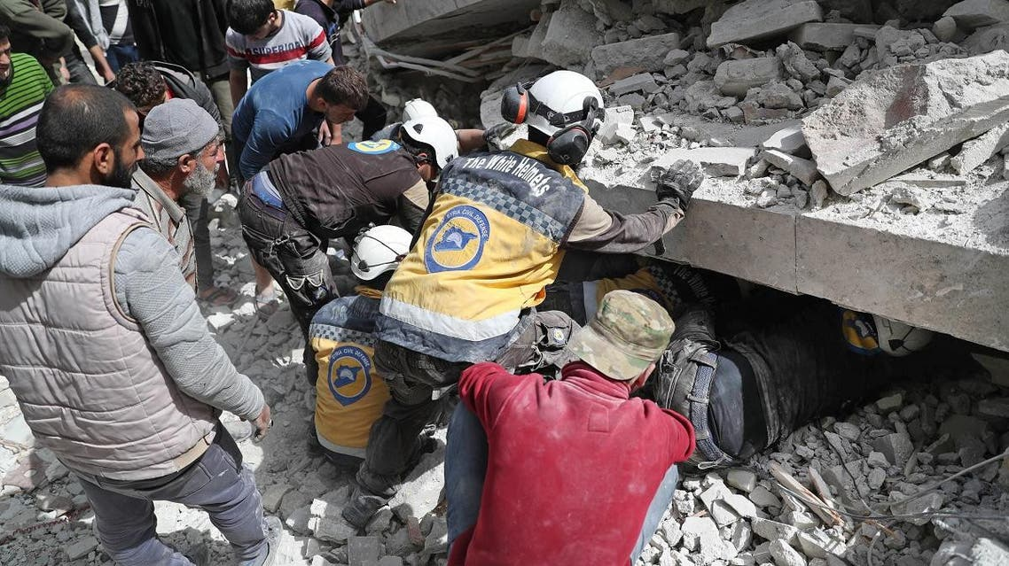 Members of the Syrian Civil Defence search the rubble of a collapsed building following an explosion in the town of Jisr al-Shughur, in the west of the mostly rebel-held Syrian province of Idlib. (AFP)
