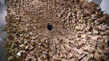 Intricate cardboard city rises in Manila art show