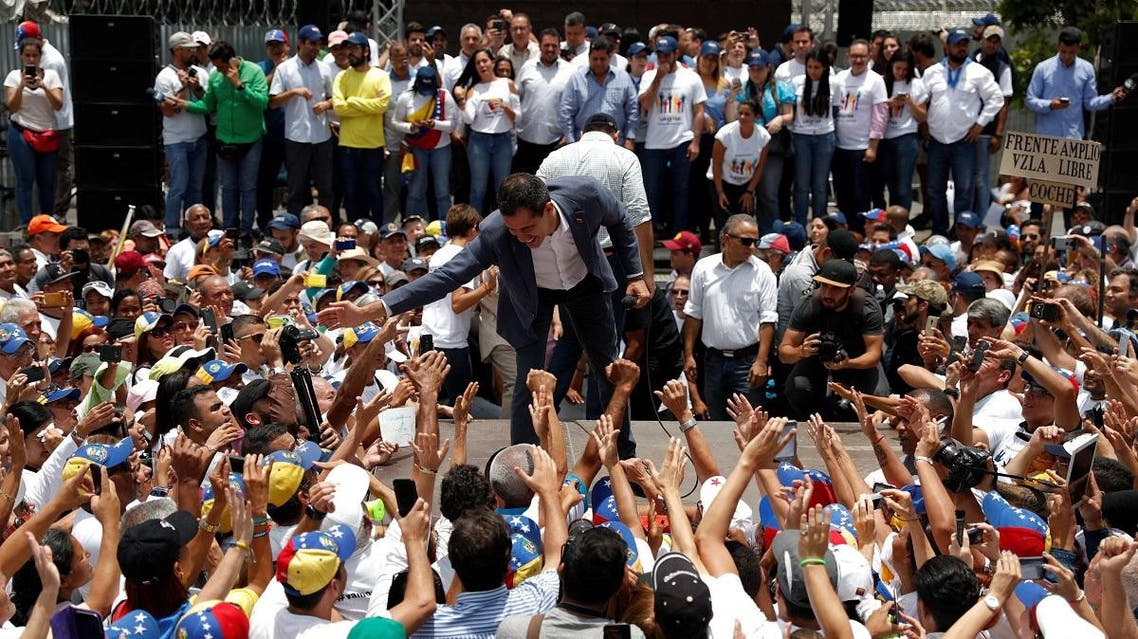 Venezuelan opposition leader Juan Guaido takes part in a swearing-in ceremony for supporters in Caracas. (Reuters)