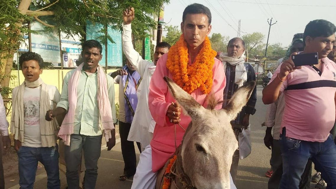 Mani Bhushan Sharma arrives on a donkey to file his nomination documents at an election office in Jehanabad, Bihar. (AFP)