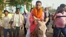 Indian politician charged after donkey ride to file papers