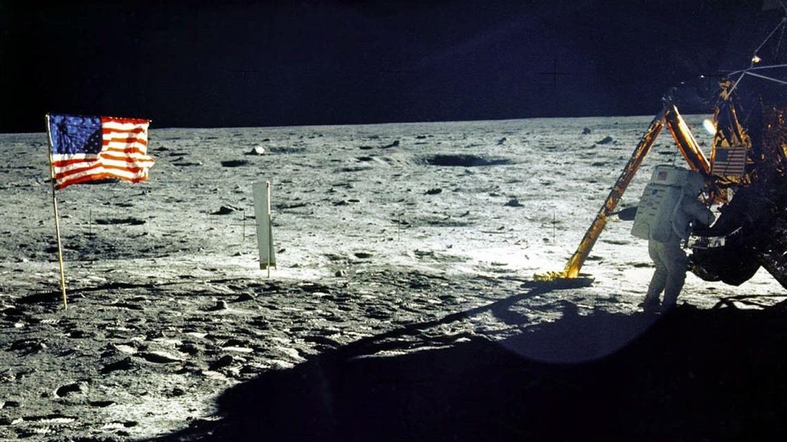 """This 20 July, 1969 file photo released by NASA shows the lunar lander and the US flag taken by Apollo 11 astronaut Edwin E. """"Buzz"""" Aldrin, Jr. on the surface of the Moon. (AFP)"""