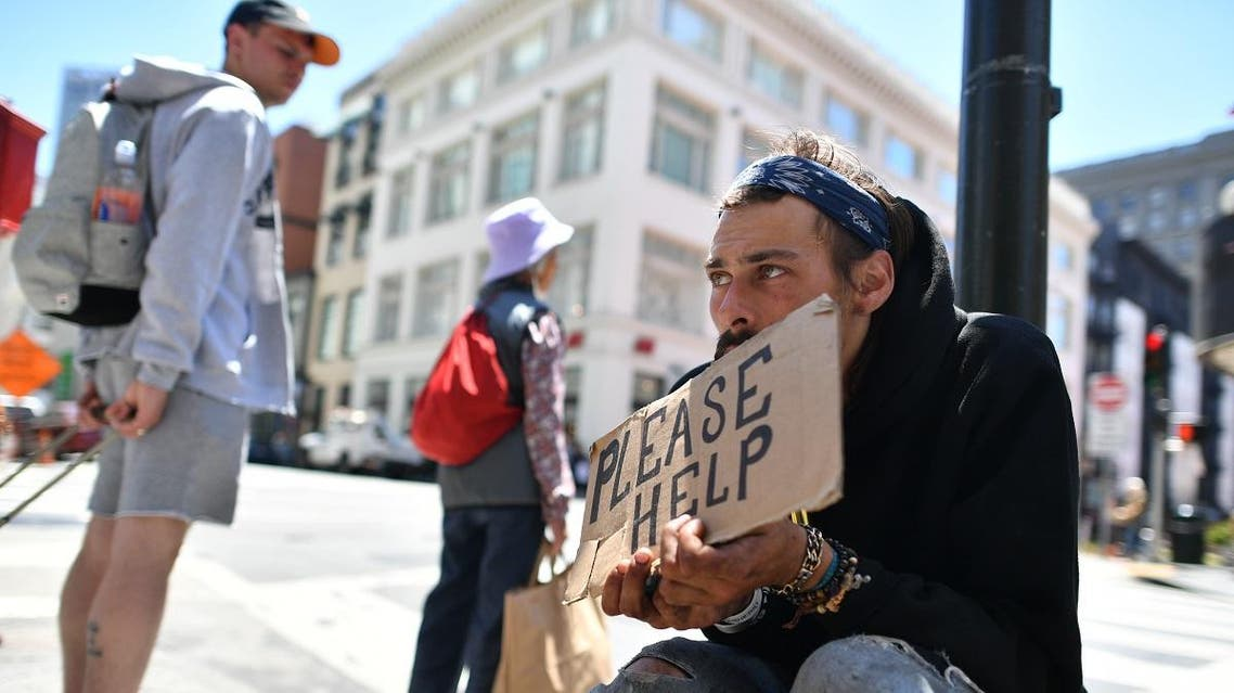 Andrew Loy begs along a sidewalk in downtown San Francisco, California on Tuesday, June, 28, 2016. (AFP)