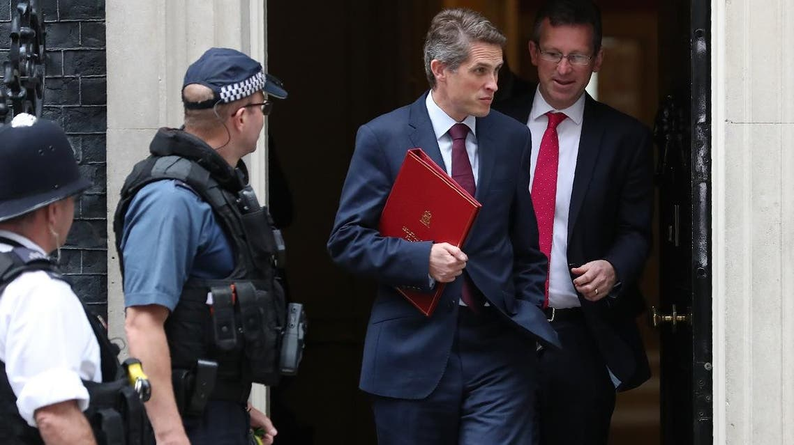 Britain's Defencse Secretary Gavin Williamson (2R) leaves 10 Downing Street in central London after the weekly cabinet meeting. (File photo: AFP)