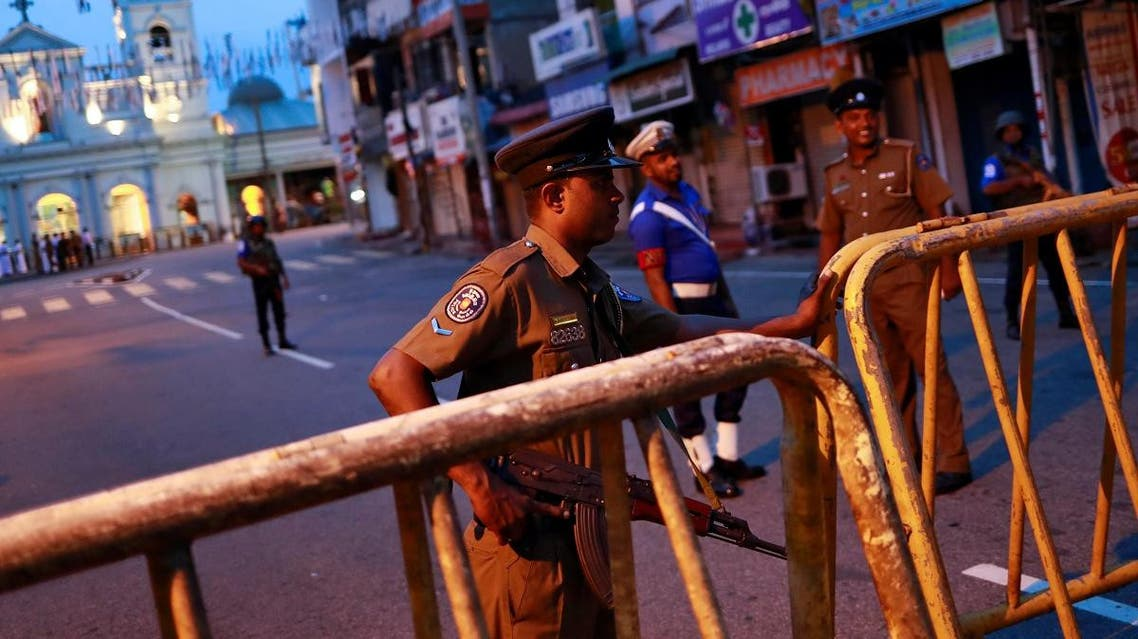 Security personnel stand guard in front of St Anthony's Shrine in Colombo. (File photo: Reuters)