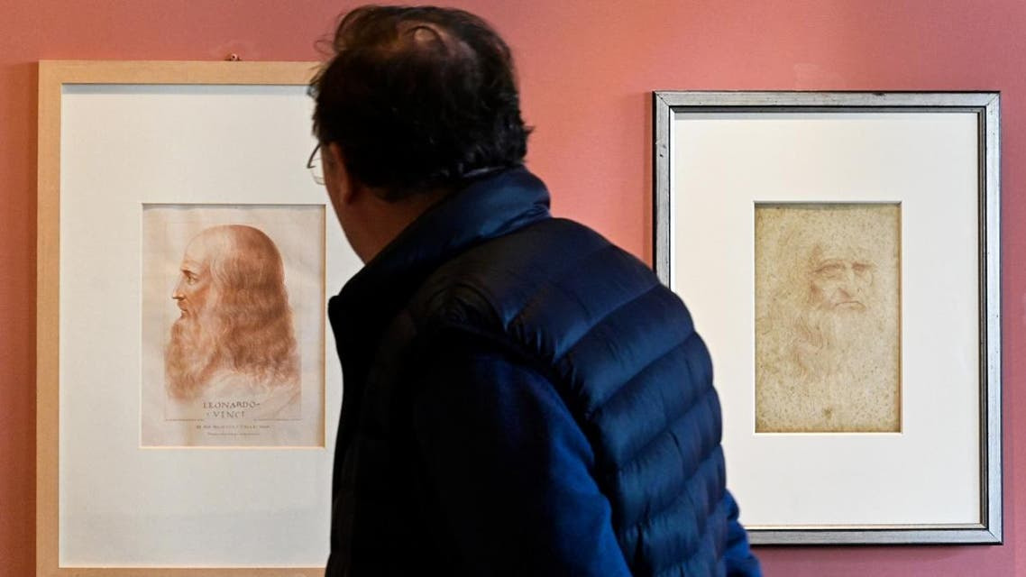 A portrait of Leonardo Da Vinci by Francesco Melzi (L) and a Da Vinci self-portrait (R) at the Leonardo Da Vinci museum during an exhibition marking the 500th anniversary of the death of Renaissance artist, on May 2, 2019 in Vinci, Tuscany. (AFP)