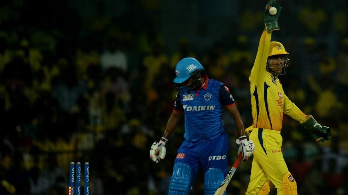 Chennai Super Kings cricket captain Mahendra Singh Dhoni (R) celebrates a wicket of Delhi Capitals Amit Mishra during the IPL Twenty20 cricket match in Chennai on May 1, 2019. (AFP)