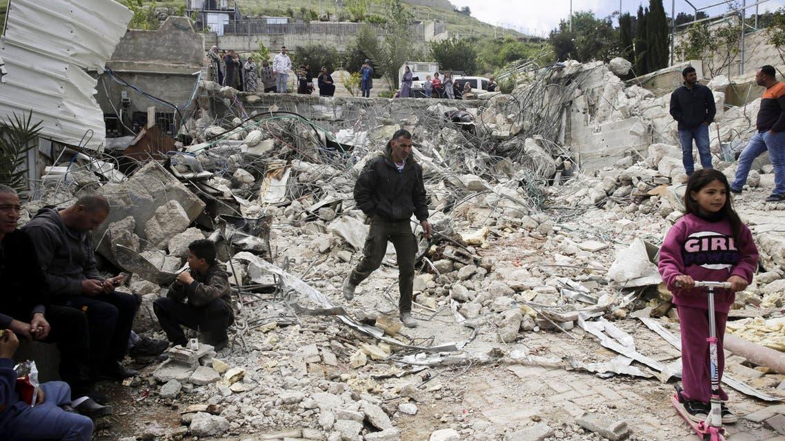 Palestinians watch a family house destroyed by Israeli authorities in east Jerusalem's neighborhood of Silwan. (AP)