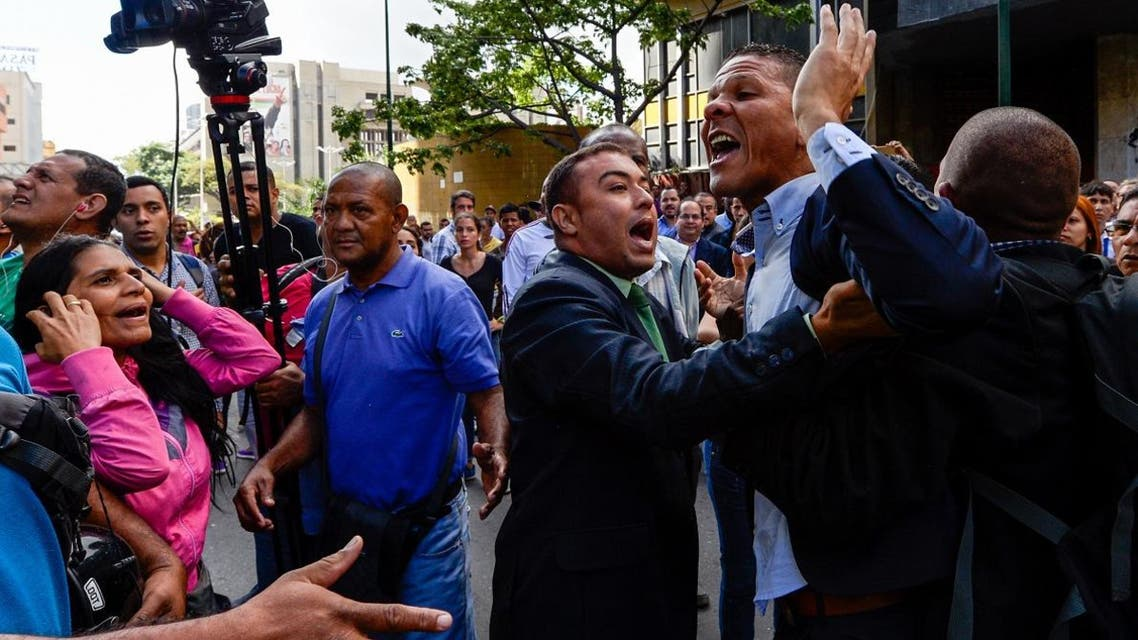 A file photo of Gilber Caro (2-R) argues with supporters of Venezuelan president Nicolas Maduro during a demonstration in Caracas. (AFP)