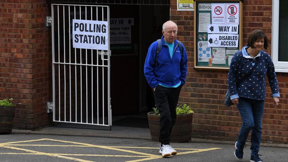 Voters leave a polling station at a community centre in Featherstone, Wolverhampton, north west England as local council elections get underway on May 2, 2019. (AFP)